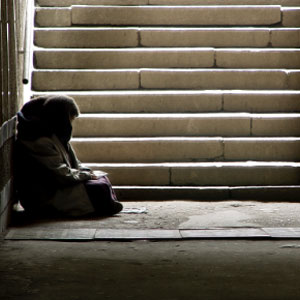 Photo of homeless person near stairwell