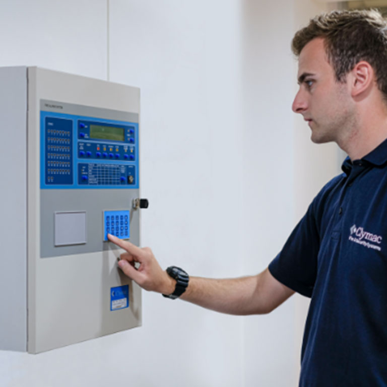 Clymac employee interacting with fire detection and alarm product system